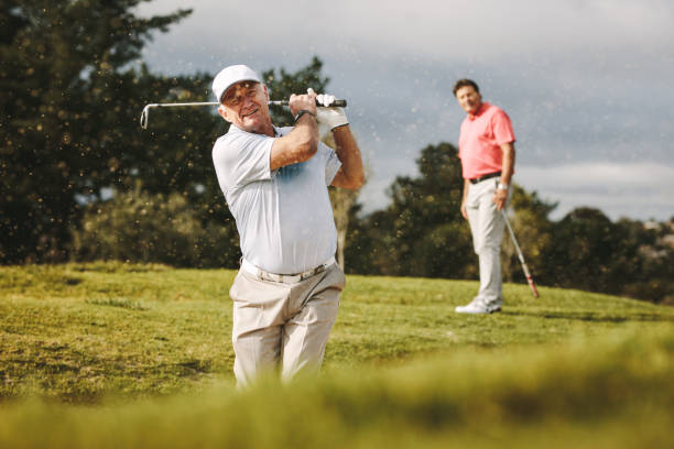pro golfer playing on the course - golf stock pictures, royalty-free photos & images