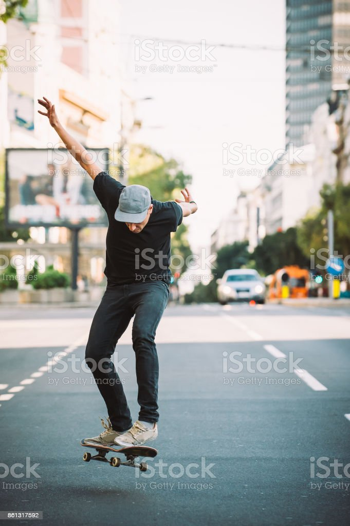 Pro skater doing tricks and jumps on street. Free ride stock photo