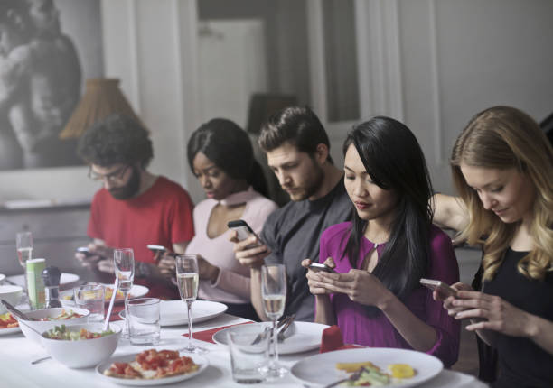 problem of the new generations - eating technology stock photos and pictures
