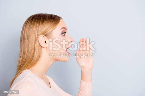 istock Problem people person share  business sale discount businesswoman whisper gossip rumor concept. Half-faced close up portrait of astonished amazed woman holding hand near mouth isolated gray background 935327572