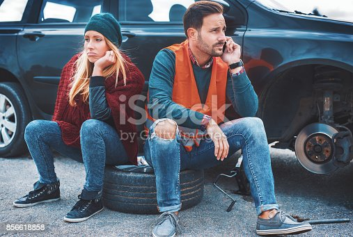 627511482 istock photo Problem with a car. A broken car on the road. Changing wheel 856618858