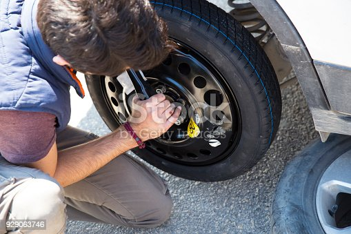 627511482 istock photo Problem with a car. A broken car on the road. Changing wheel 929063746