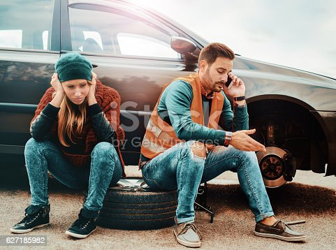 627511482 istock photo Problem with a car. A broken car on the road. 627185982