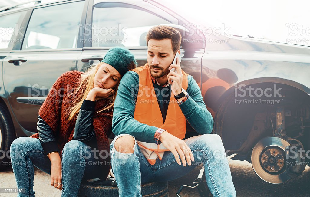 Problem with a car. A broken car on the road. stock photo
