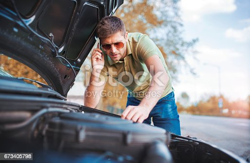 627511482istockphoto Problem with a car. A broken car on the road 673405798