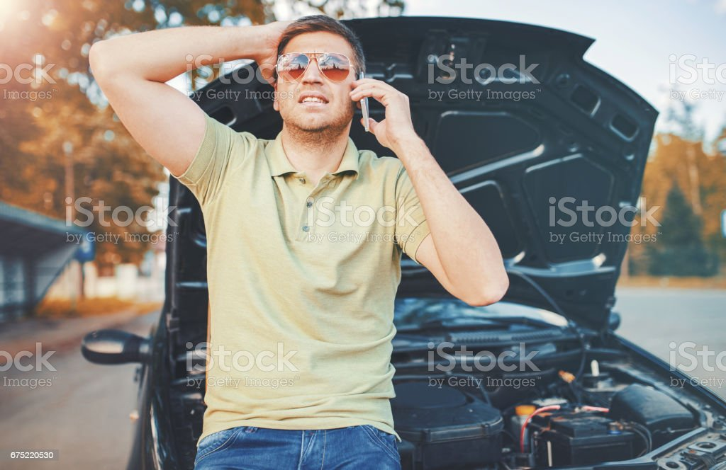 Problem with a car. A broken car on the road royalty-free stock photo