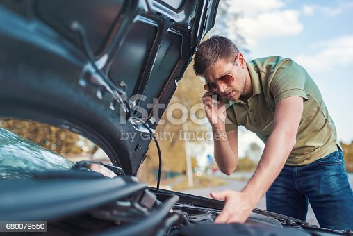 627511482 istock photo Problem with a car. A broken car on the road 680079550