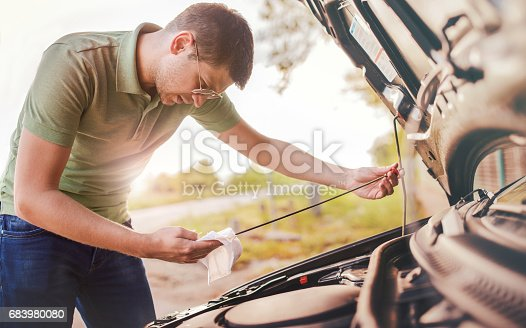 627511482 istock photo Problem with a car. A broken car on the road 683980080