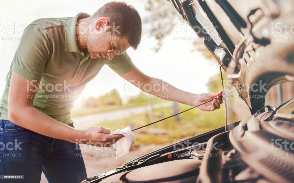 Problem with a car. A broken car on the road stock photo