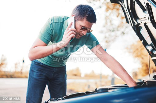627511482istockphoto Problem with a car. A broken car on the road 700181466