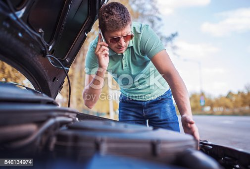 627511482istockphoto Problem with a car. A broken car on the road 846134974
