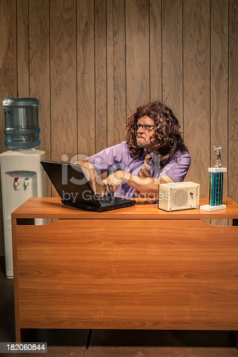 618210072 istock photo Problematic Work Place Scene with Shaggy Haired IT Computer Guy 182060844