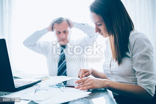 672116416istockphoto Problems at the office 535516390