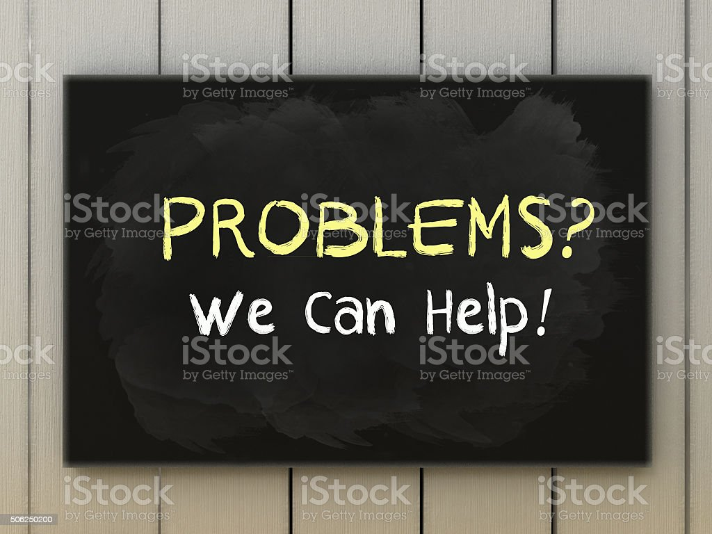 Problems, we can help on blackboard written with chalk. stock photo