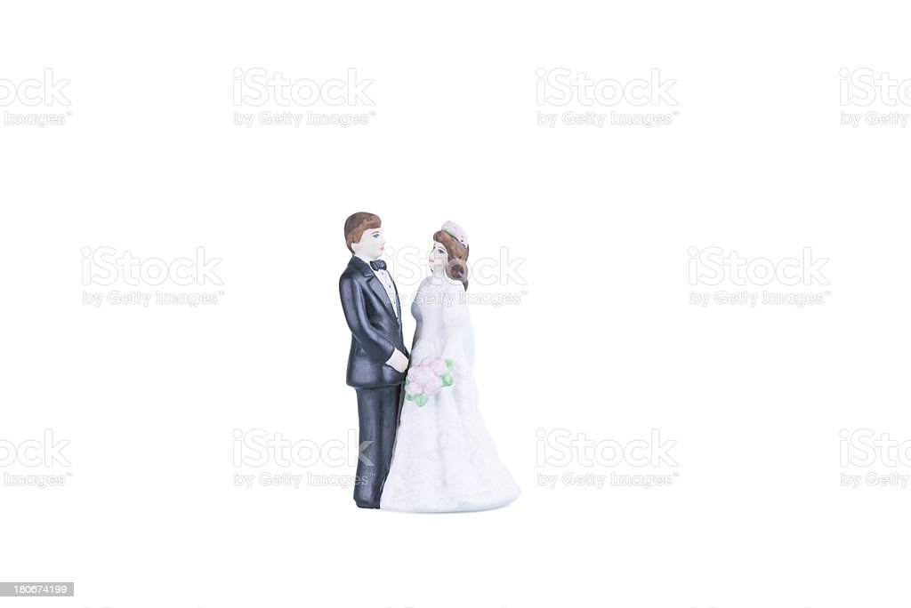 Procelain bride and groom over white background royalty-free stock photo