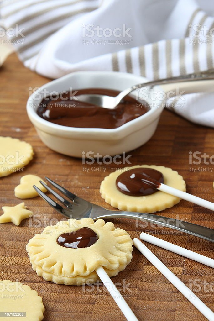 Process of baking shortbread cookies pops with chocolate stock photo