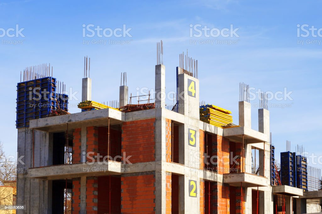 process of building a multi-storey building. construction site. The concept of growth and movement stock photo