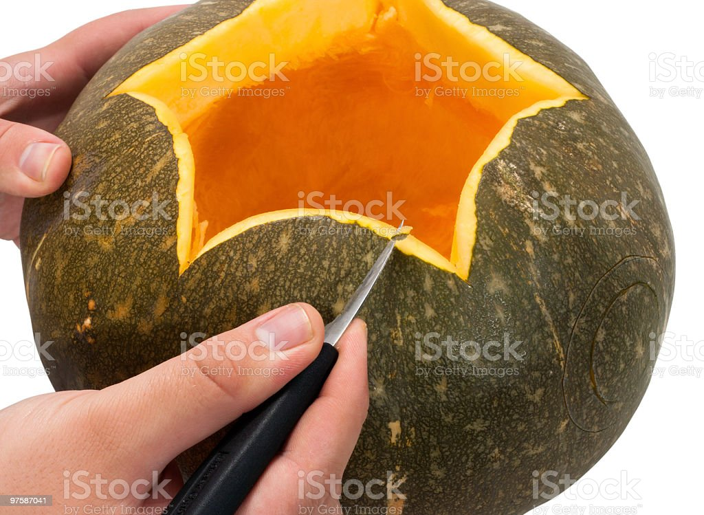 Process of carving a pumpkin royalty-free stock photo