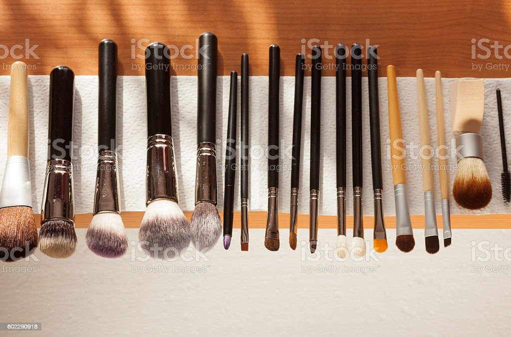 Process of cleaning drying makeup brushes stock photo