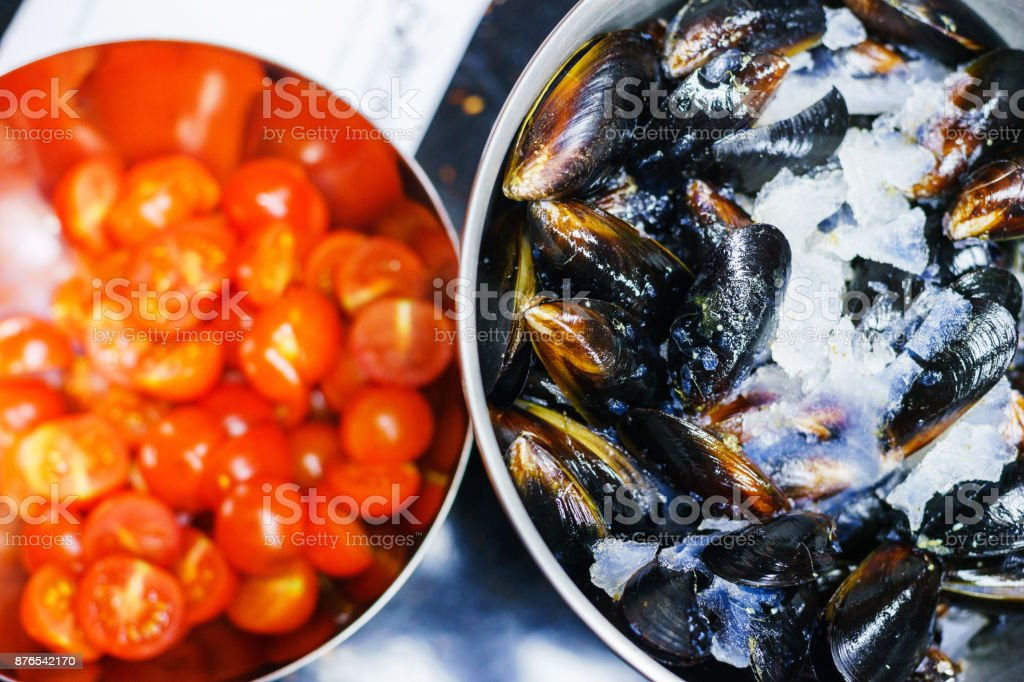 Process of cooking boiled oysters in the sinks in the kitchen in a cafe or restaurant. stock photo