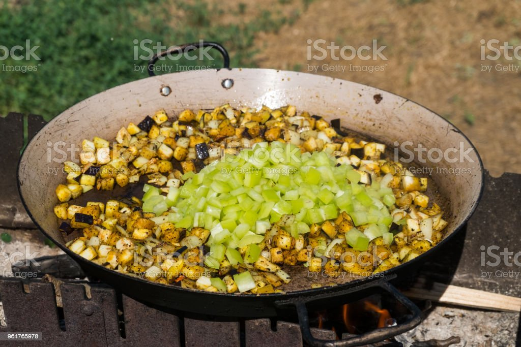 Process of cooking paella with seafood royalty-free stock photo