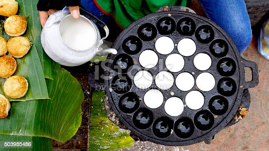 Process of cooking Sweet and Savory Grilled Coconut-Rice Hotcakes, Coconut Rice Cake on banana packaging, Asian dessert, Thai, Thailand, Luang Prabang, Laos