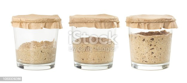 Process of fermentation of homemade rye bread sourdough isolated on white background. Active rye starter for bread. Healthy eating concept.
