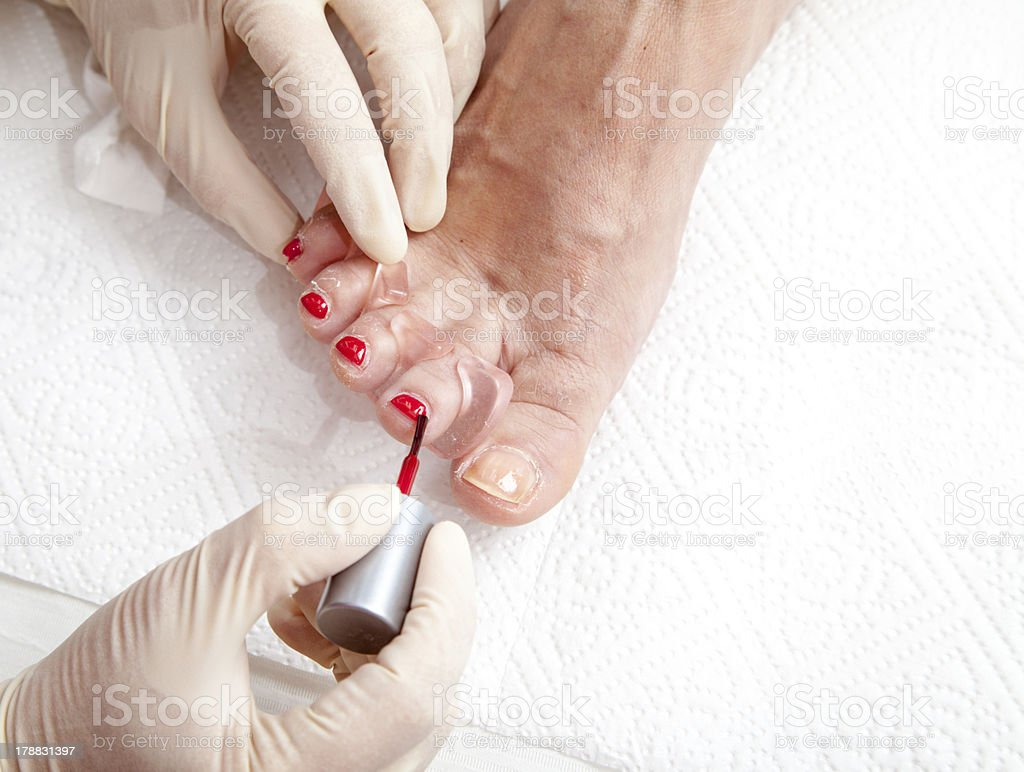 Process of foot nail varnishing royalty-free stock photo