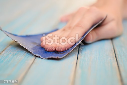 Process of hand polishing wooden board surface with sandpaper