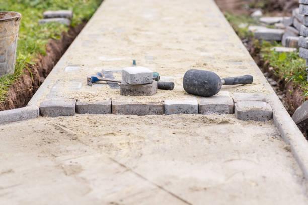 Process of laying pavement at yard. Work tools. Ukraine stock photo