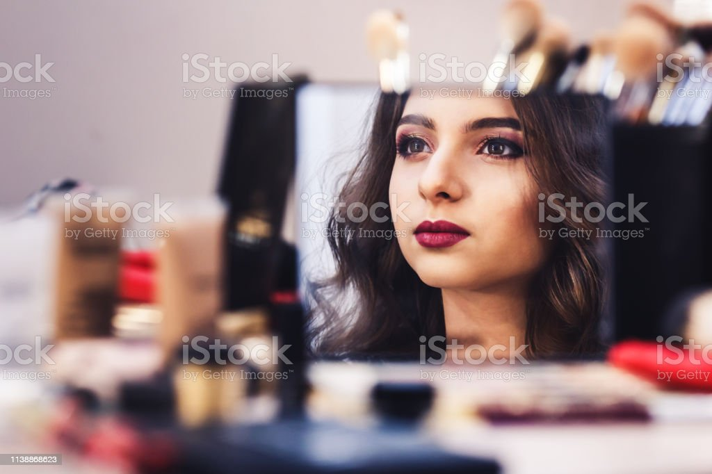 Process Of Making Makeup Face Of Model Is Reflected In