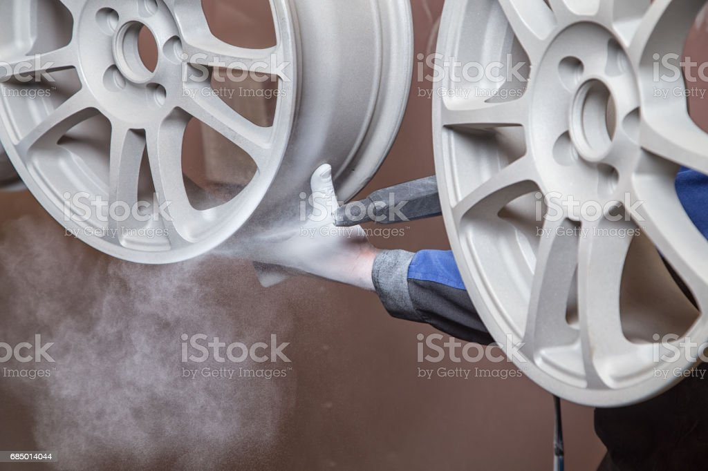 Process of powder coating wheels stock photo