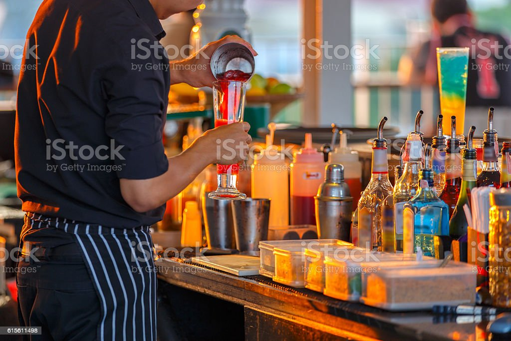 Process of preparing a cocktail bartender's from passion fruits royalty-free stock photo