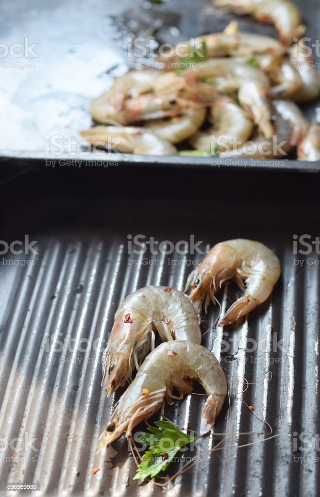 Process of preparing shrimp on  grill stock photo