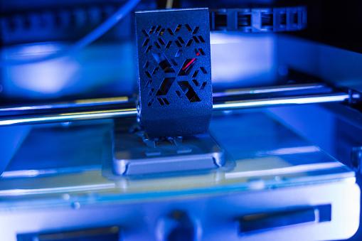 istock Process of printing plastic model on automatic 3d printer machine 1150837419