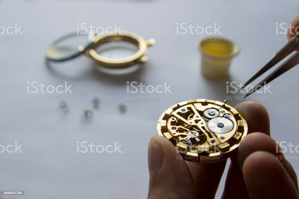 Process of repair of mechanical watches stock photo