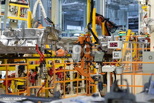 1069360792 istock photo process of welding cars. Modern Assembly of cars at plant. automated build process of car body 1066926820