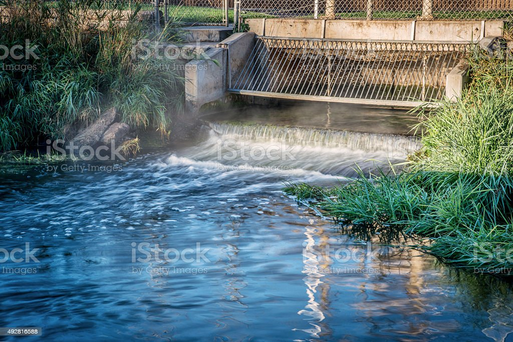 Processed and cleaned sewage outflow stock photo