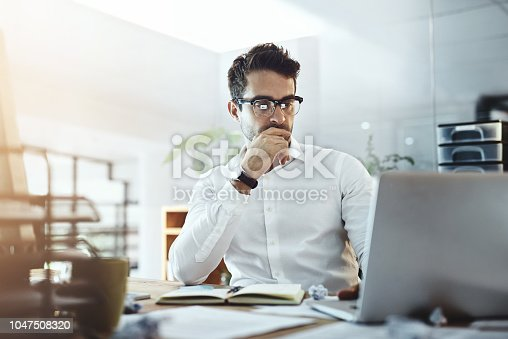 Shot of a young businessman working in an office