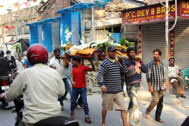 Procession of a dead person in the streets of Kolkata stock photo