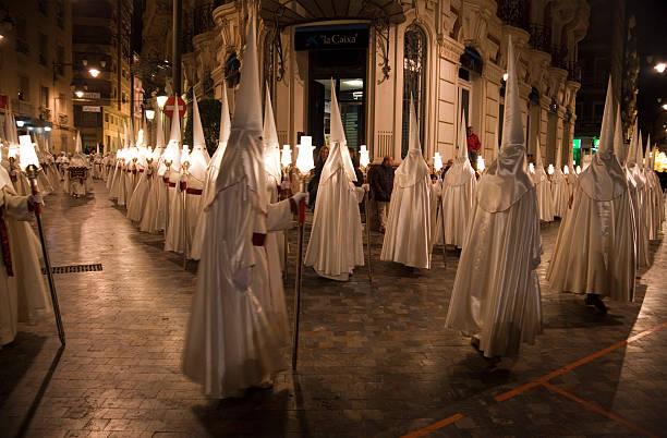 Procession of Nazarenos during Semana Santa in Cartagena, Spain stock photo