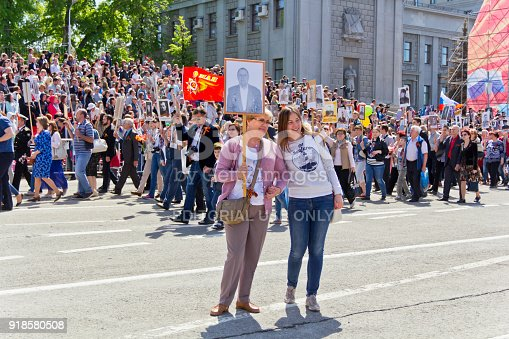 istock Procession of the people in Immortal Regiment on annual Victory Day, May, 9, 2016 in Samara, Russia. 918580508