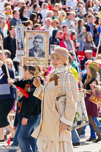 istock Procession of the people in Immortal Regiment on annual Victory Day, May, 9, 2016 in Samara, Russia. 918583092