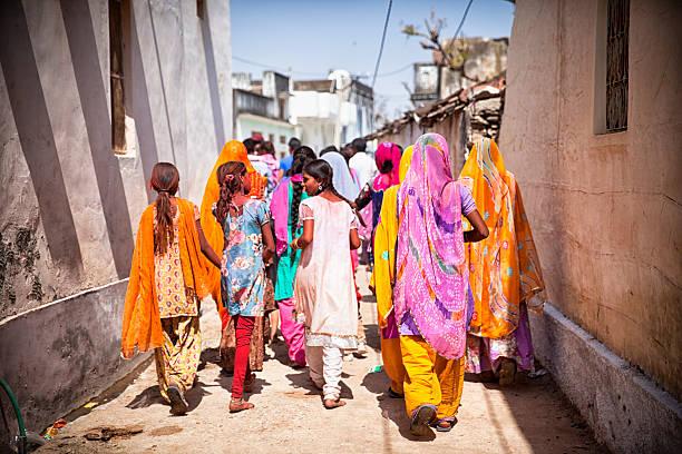 Procession of Women and Children. Holi Festival. stock photo