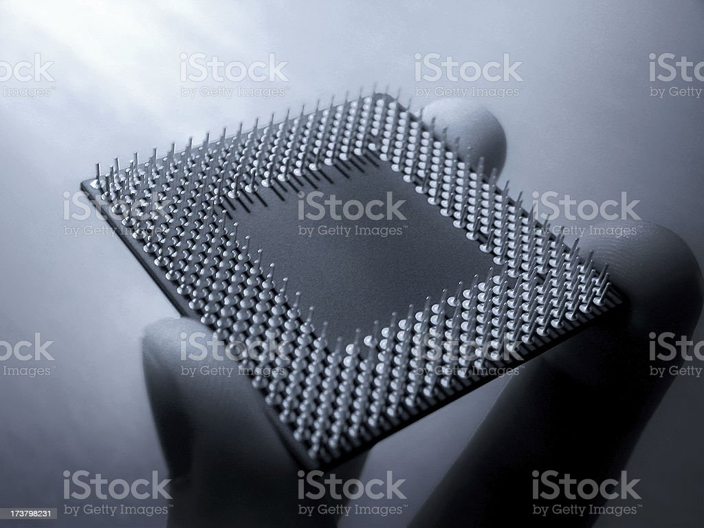 CPU Processor chip held in fingers stock photo