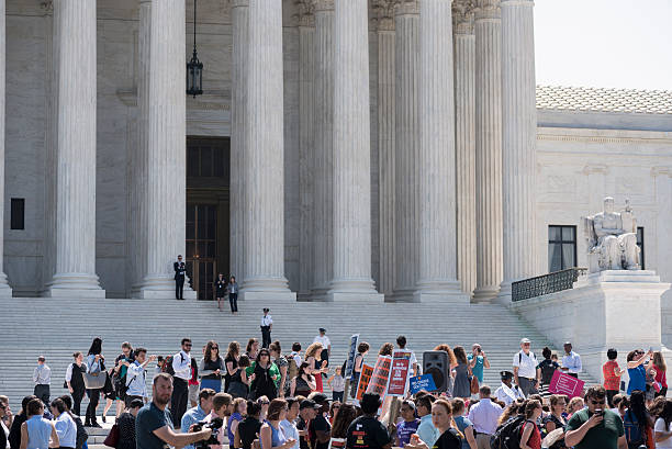 Pro-choice supporters outside the U.S. Supreme Court Washington DC, USA - June 27, 2016: Pro-choice supporters celebrate in front of the U.S. Supreme Court after the court, in a 5-3 ruling, struck down a Texas abortion access law. pro choice stock pictures, royalty-free photos & images