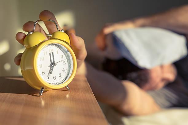 procrastination - alarm stock photos and pictures