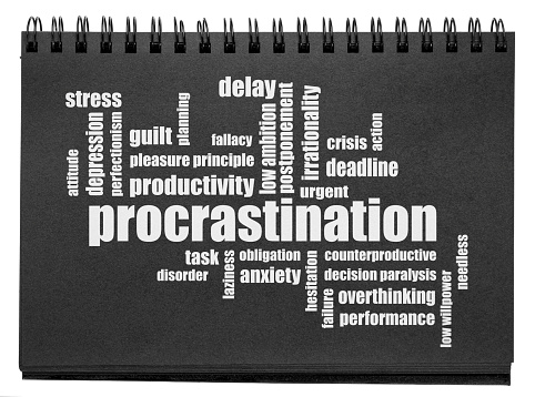 procrastination word cloud - white text in an isolated black paper sketchbook