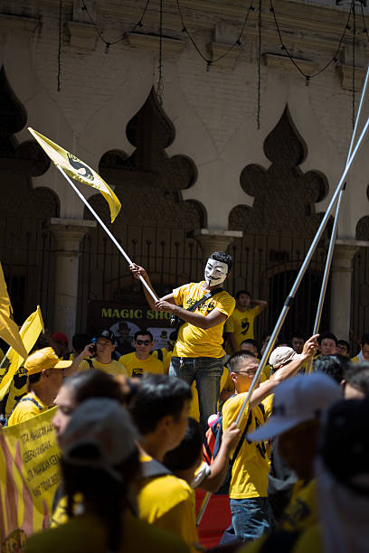pro-democracy bersih 5.0 protesters rally - guy fawkes mask stock photos and pictures
