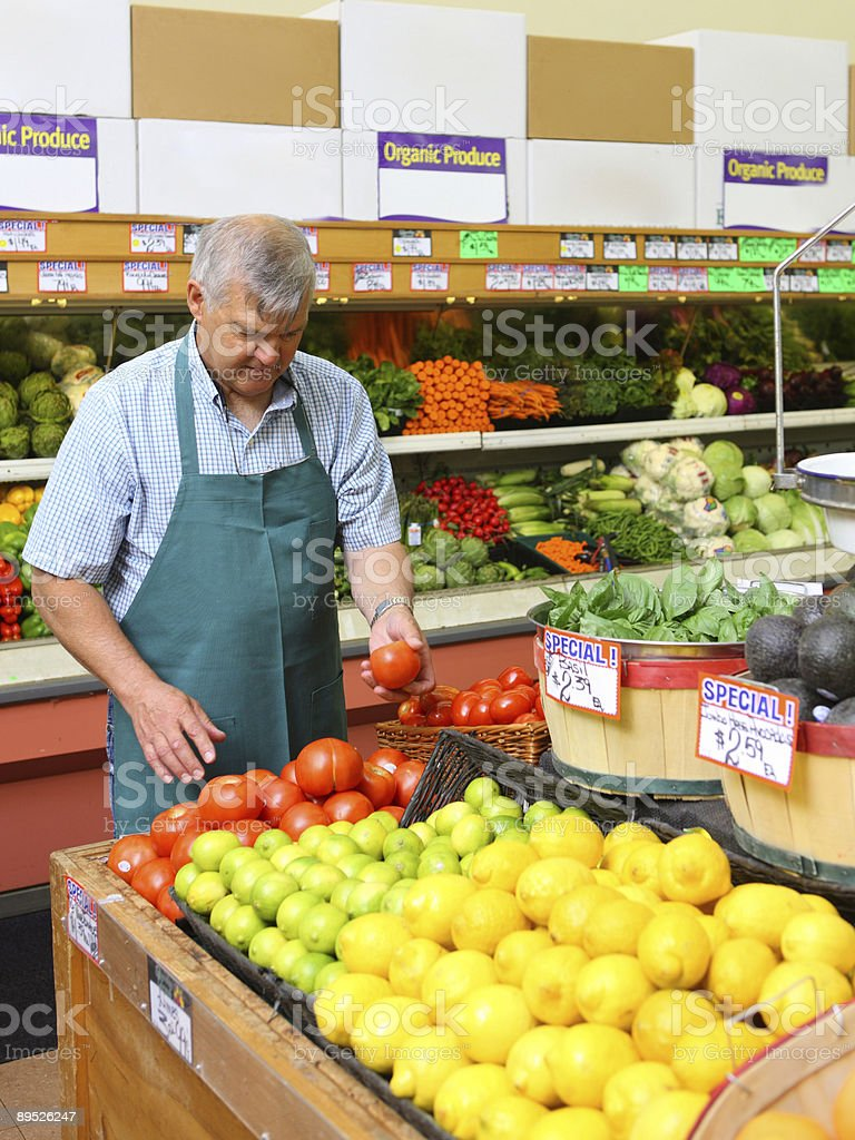 Produce man in grocery store royalty-free stock photo